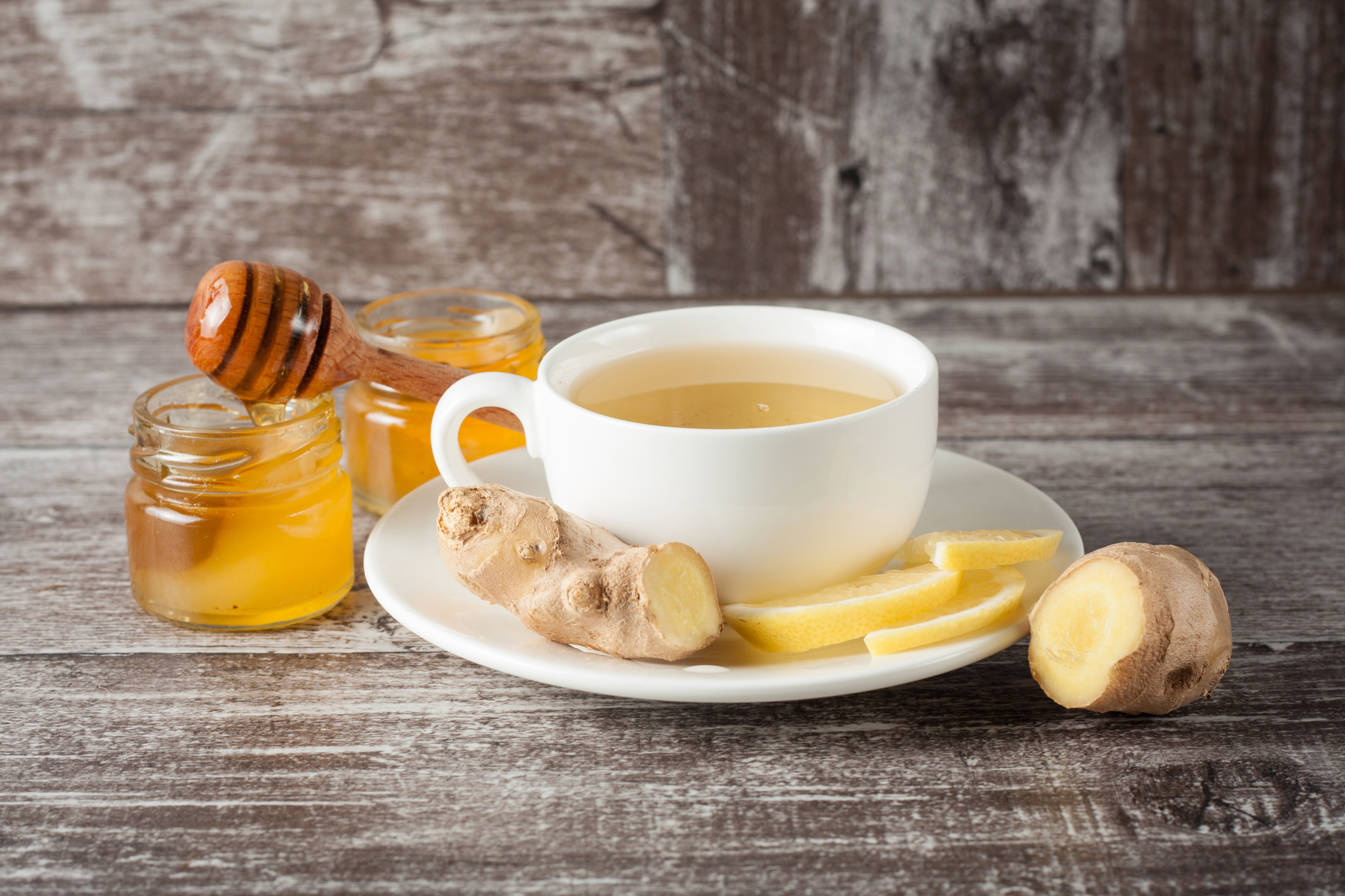 http://www.shutterstock.com/pic-332345660/stock-photo-a-white-cup-of-green-natural-tea-with-ginger-lemon-and-honey-on-wooden-rustic-background-healthy.html?src=UvaLLrjuu8mbTnIYccf9dQ-1-7