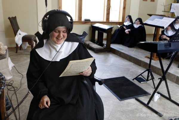 Mother Cecilia, Prioress, listens to a playback while sisters look on. Image by Karen Pulfer Focht, with permission