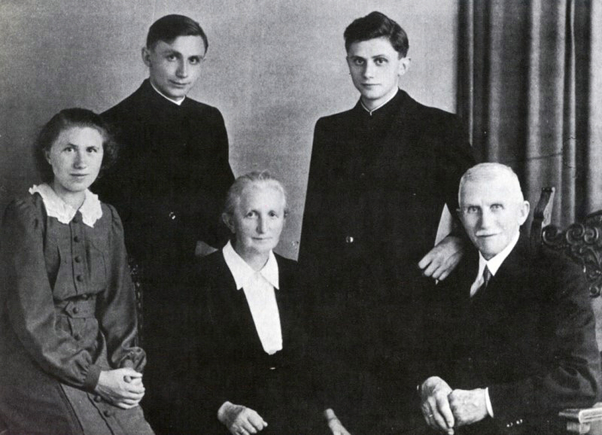 Picture taken in 1951 shows the family of Josef Ratzinger (up, R) in Freising, Bavaria, after the ordination of himself and his brother Georg (up L). Germany's Cardinal Joseph Ratzinger was elected the 265th pope of the Roman Catholic Church on 19 April 2005 and took the name Benedict XVI. Bottom row : his sister Maria, his Mother Maria and his father Josef.