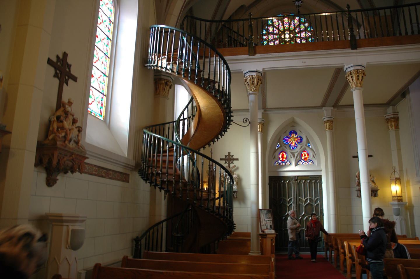 When the chapel was ready, builders were faced with an unexpected problem: they could not add a ladder leading from the nave to the choir, on the second floor.