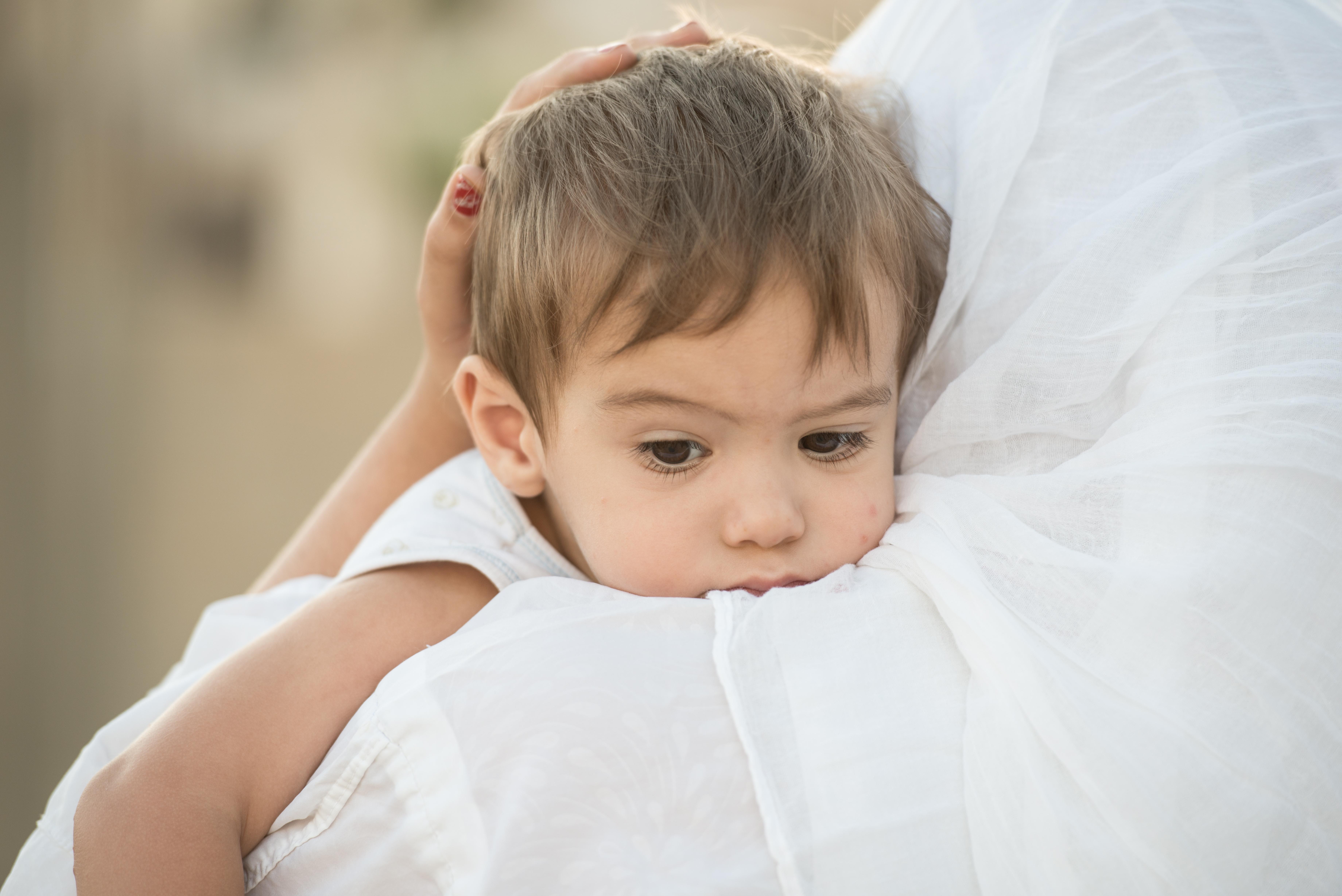 refugee-mother-child-ZouZou-shutterstock_246979801,jpg