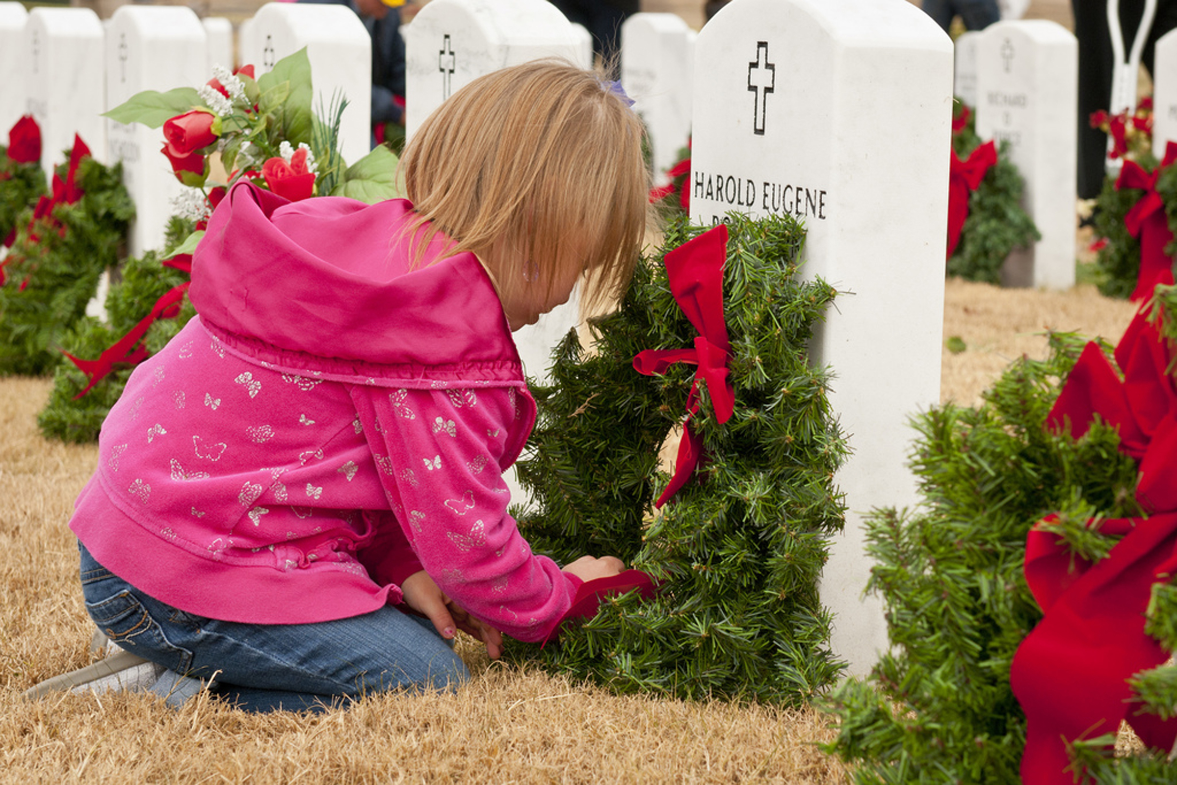 YOUNG GIRL AT GRAVE