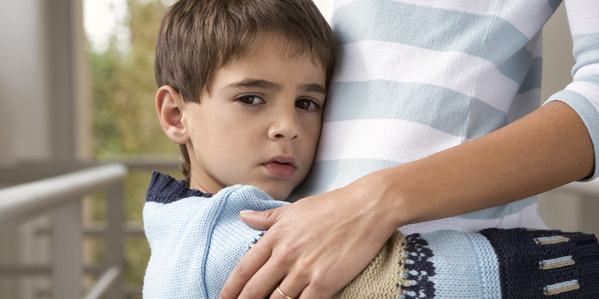 BOY HUGGING MOTHER