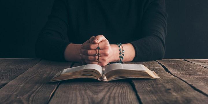 Woman Praying bible